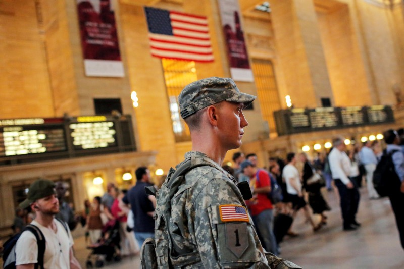 member of the U.S. Army National Guard monitors commuters at Grand Central Station as security increases leading up to the Fourth of July weekend in Manhattan,