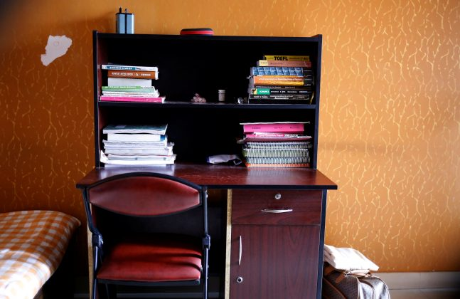 Study table of Meer Saameh Mubasheer is pictured in his room at his family home, in Dhaka