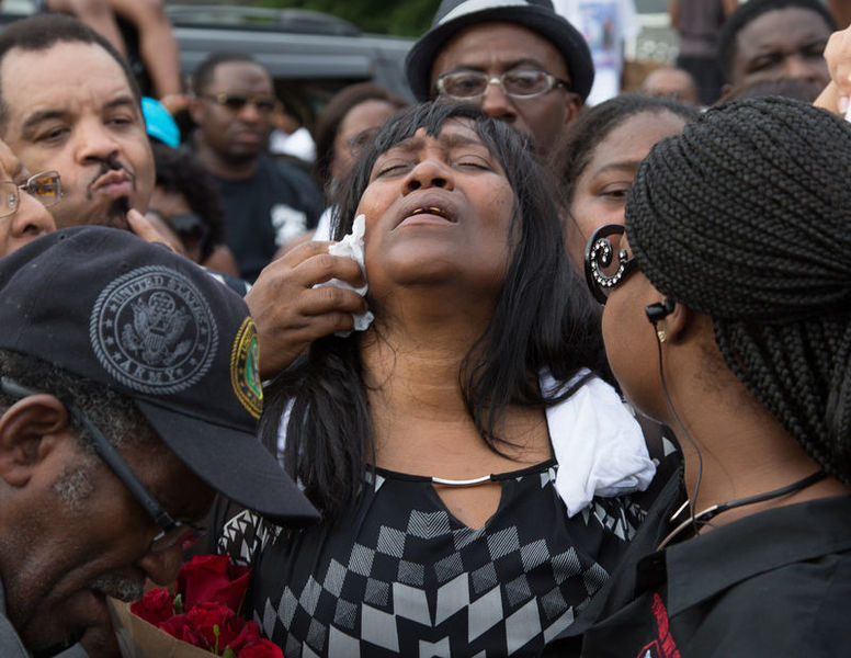 Sandra Sterling, reacts during community vigil in memory of her nephew, Alton Sterling, who was shot dead by police, at the Triple S Food Mart in Baton Rouge, Louisiana, U.S.