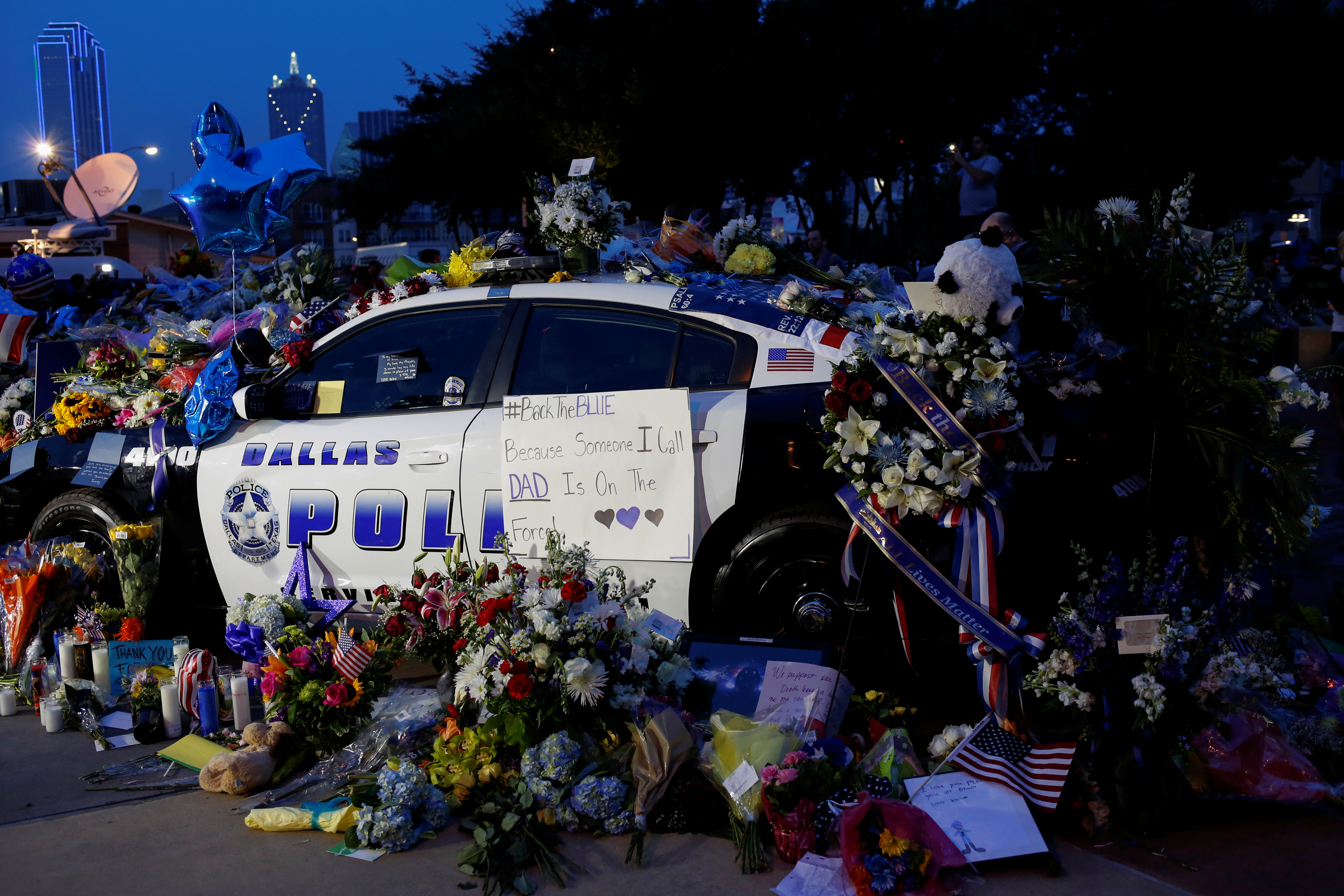 A makeshift memorial at Dallas Police Headquarters one day after a lone gunman ambushed and killed five police officers at a protest decrying police shootings