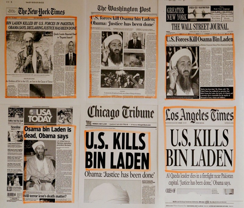 Newspaper headlines and clippings are posted on a wall inside a staff office at the White House in Washington May 2, 2011, the morning after U.S. President Barack Obama announced the death of Osama bin Laden.