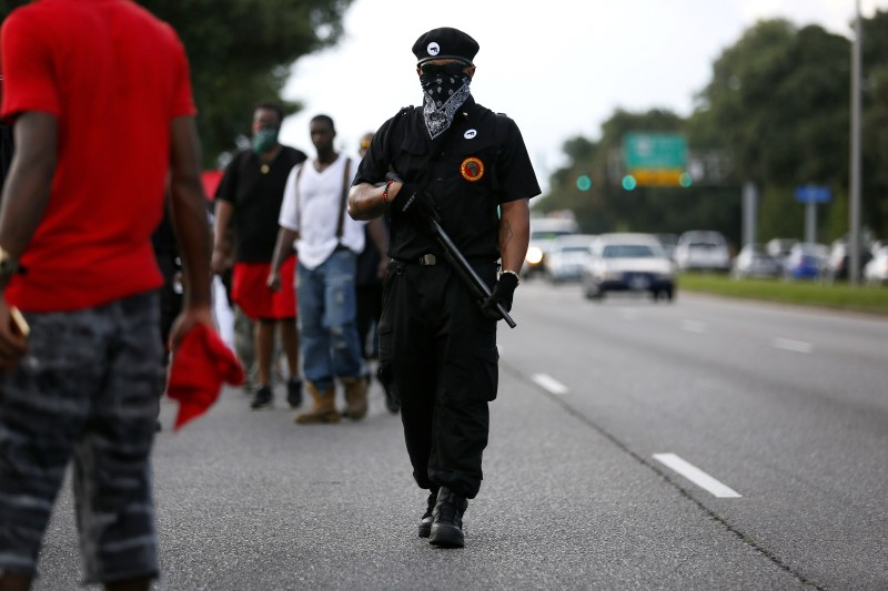 Demonstrator and member of New Black Panthers Party