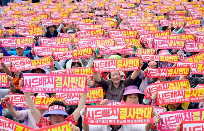 Residents chant slogans during a protest against goverments decision on deploying a U.S. THAAD anti-missile defense unit in Seongju