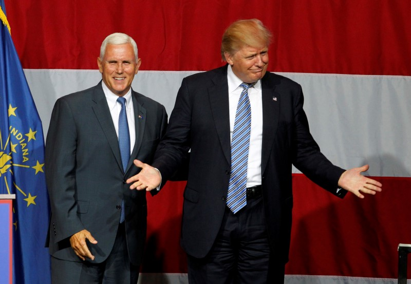 Republican presidential candidate Donald Trump and Indiana Governor Mike Pence wave to the crowd before addressing the crowd during a campaign stop at the Grand Park Events