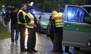 Police meet at scene of shooting rampage in Munich