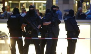 Special forces stand guard in front of Munich Mall