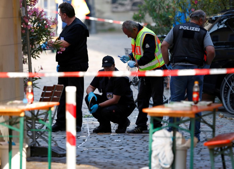 Police secure the area after an explosion in Ansbach, Germany,