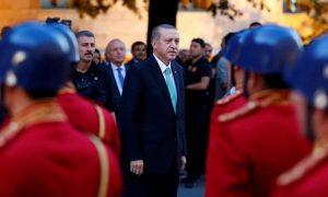 Turkish President Tayyip Erdogan reviews a guard of honour as he arrives to the Turkish Parliament in Ankara, Turkey, Ju