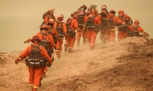 Inmate firefighters file off to construct a fire break while battling the Soberanes Fire in Carmel Highlands, California,
