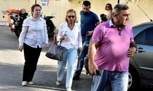 Turkish journalist Nazli Ilicak is escorted by a police officer and her relatives after being detained and brought to a hospital for a medical check in Bodrum