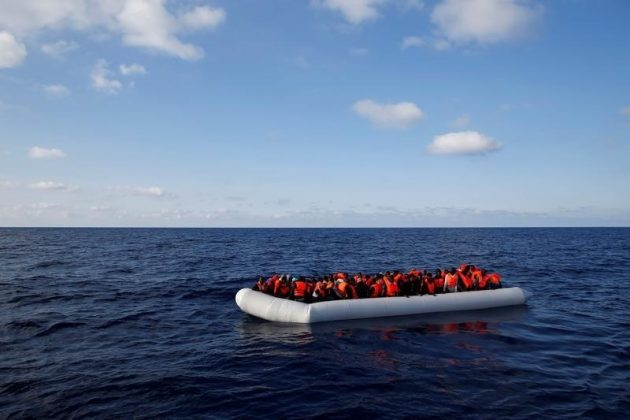 Migrants await rescue in dinghy
