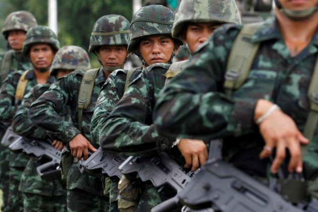 Thai soldiers attend a morning training at military barracks in Prachin Buri outside Bangkok, Thailand