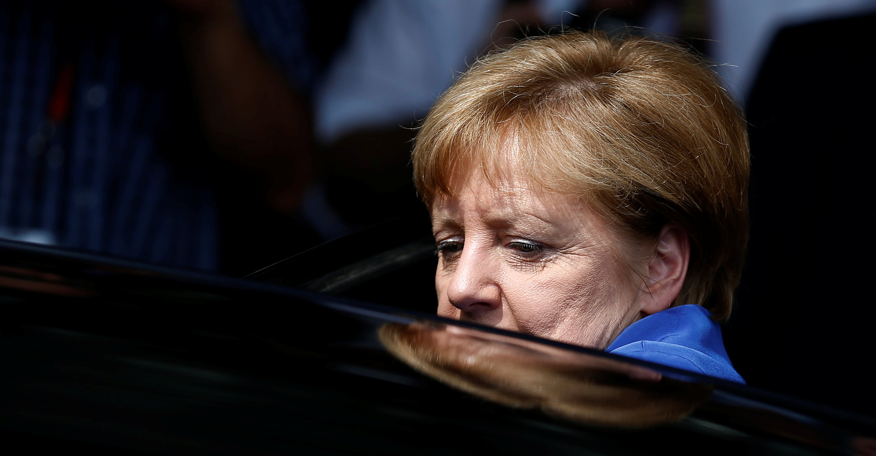 German Chancellor Merkel leaves a news conference in Berlin