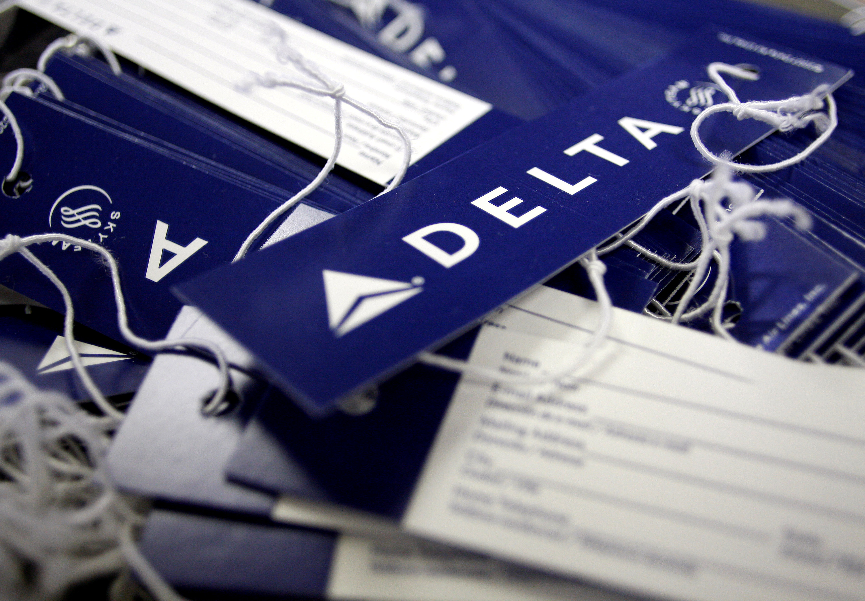elta airline name tags are seen at Delta terminal in JFK Airport in New York