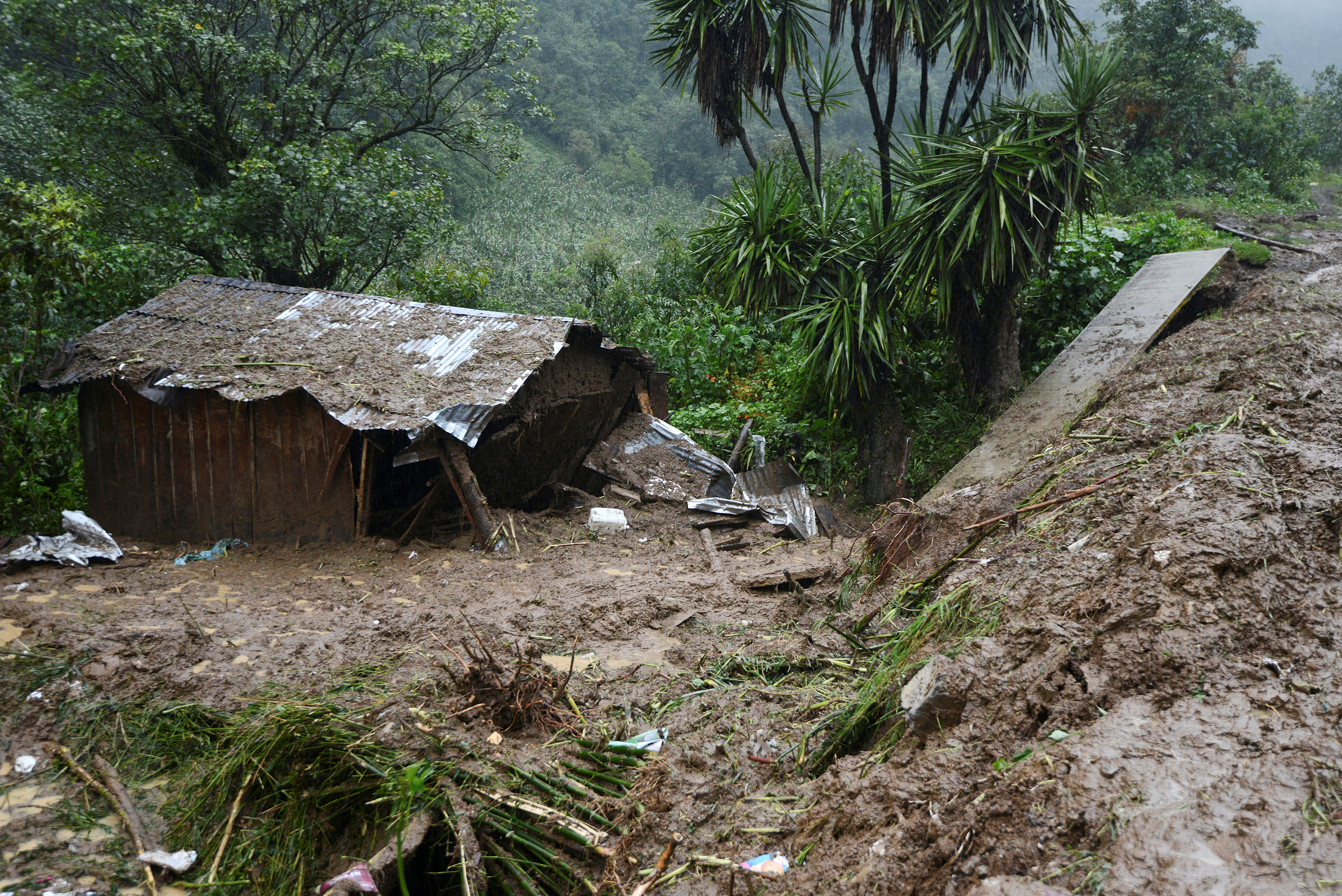 A view of the house where three members of a family died after a mudslide following heavy showers caused by the passing of Tropical Storm Earl in the town of Temazolapa