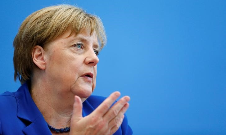 German Chancellor Angela Merkel addresses a news conference in Berlin, Germany