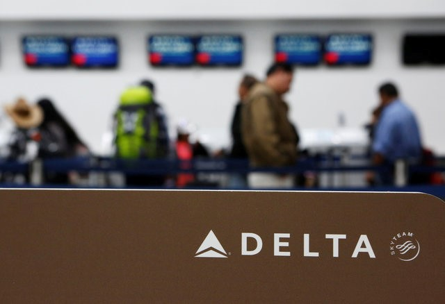 Passengers check in at a counter of Delta Air Lines in Mexico City, Mexico, August 8, 2016.
