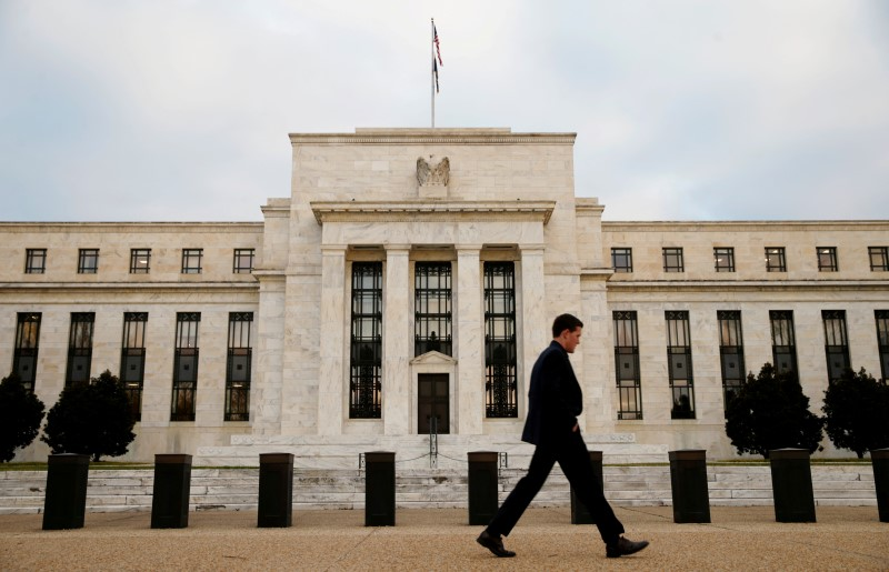 A man walks past the Federal Reserve Bank in Washington, D.C., U.S.