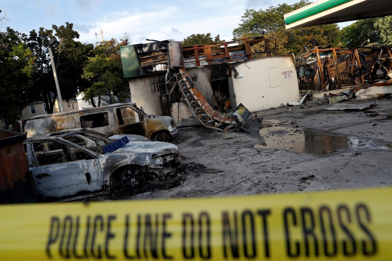 A gas station is seen burned down after disturbances following the police shooting of a man in Milwaukee, Wisconsin, U.S.
