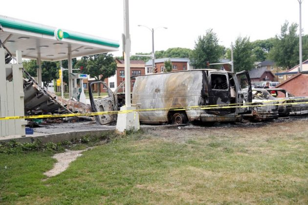A burned down gas station is seen after disturbances following the police shooting of a man in Milwaukee, Wisconsin,
