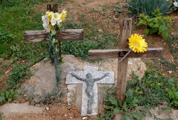 Wooden crosses for an unmarked refugee grave