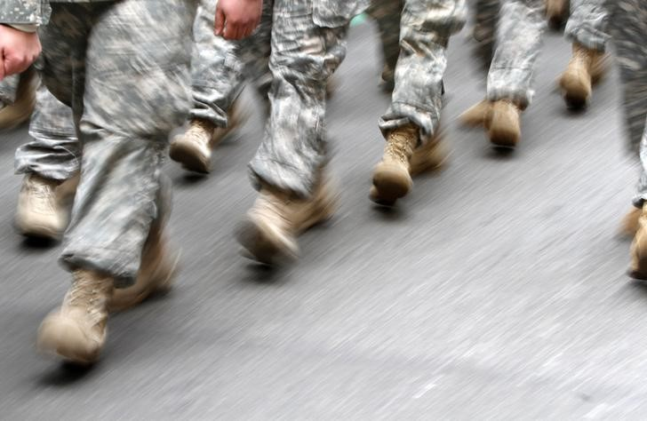U.S. army soldiers are seen marching in the St. Patrick's Day Parade in New York, March 16, 2013