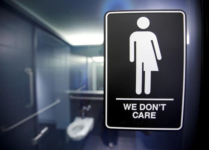 A sign protesting a recent North Carolina law restricting transgender bathroom access in Durham, North Carolina