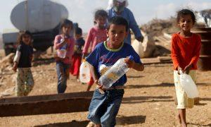 Palestine children carrying water