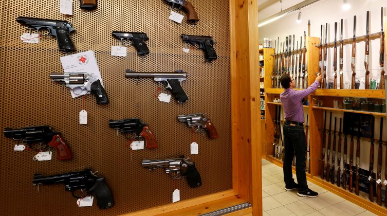 Handguns and sporting guns are displayed at Wyss Waffen gun shop in Burgdorf