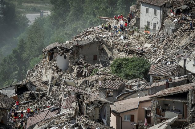 rescuers helping those in Italian quake