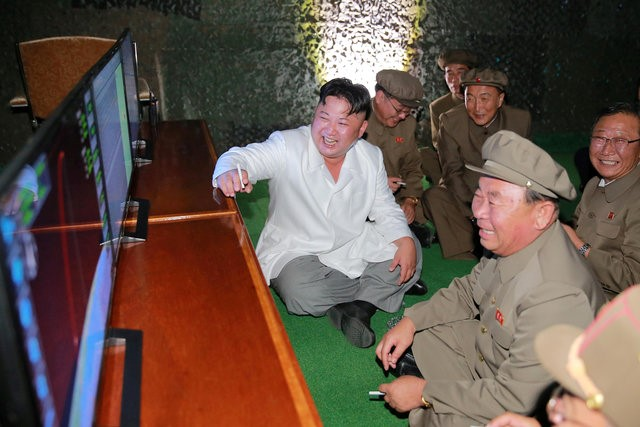 North Korean leader Kim Jong Un is pictured during a test-fire of strategic submarine-launched ballistic missile