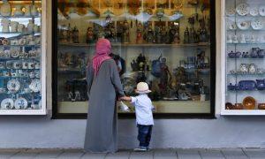A woman wears an Islamic headdress while visiting Garmisch-Partenkirchen, Germ
