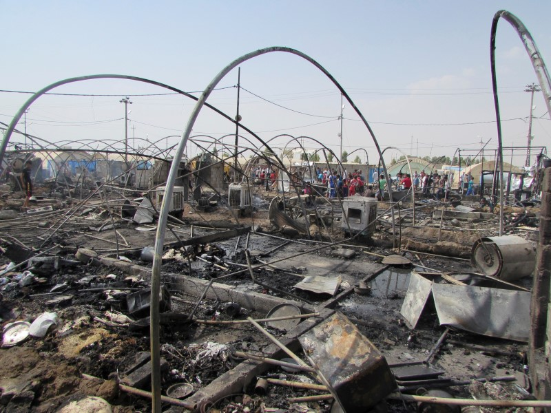 Tents that were destroyed by fire are seen at Yahayawa refugee camp near Kirkuk, Iraq,