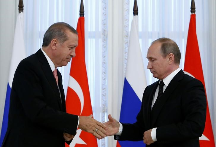 Russian President Putin shakes hands with Turkish President Erdogan during news conference following their meeting in St. Petersburg
