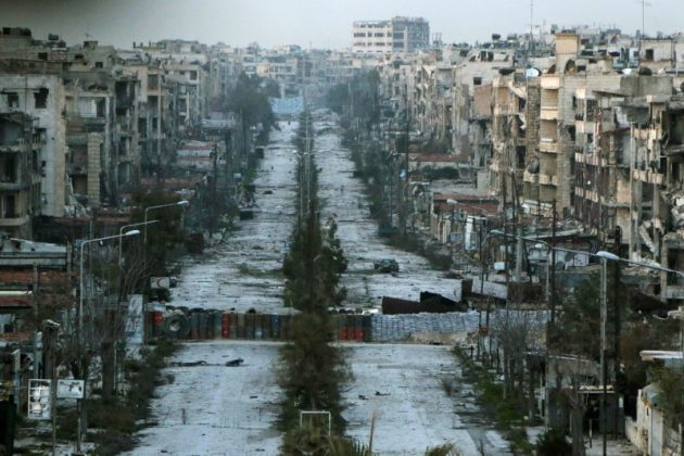 A general view shows a damaged street with sandbags used as barriers in Aleppo's Saif al-Dawla