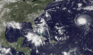 Three storm systems are shown (L TO R) Tropical Depression Nine to the southeast of Florida, Tropical Depression Eight just off the coast of the Carolinas and Hurricane Gaston in the central Atlantic Ocean are shown in this GOES East satellite image captured August 29, 2016.