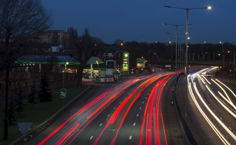 Traffic passes a BP gas station on the North Circular Road in London,