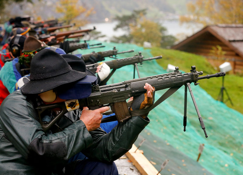 Participants fire their infantry and assault rifles during the traditional 'Ruetlischiessen' (Ruetli shooting) competition at the Ruetli meadow in central Switzerland