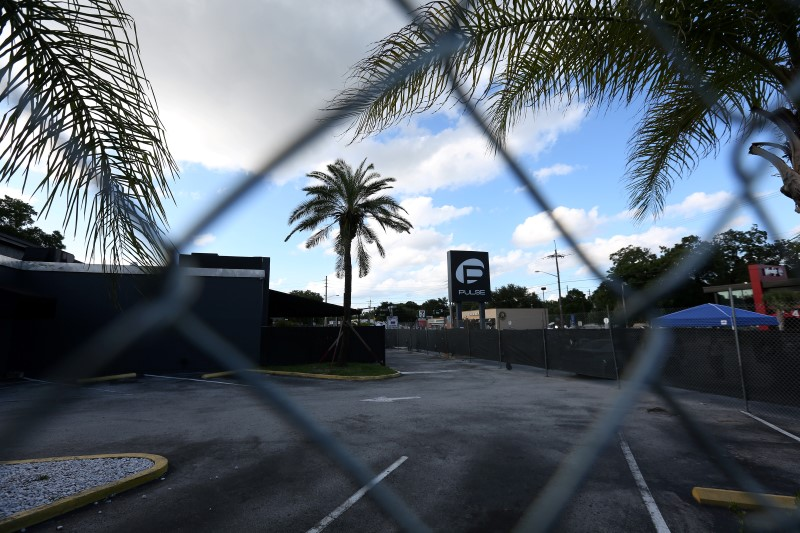 The Pulse night club sign is pictured through a fence following the mass shooting there last week in Orlando, Florida, U.S., June 21,