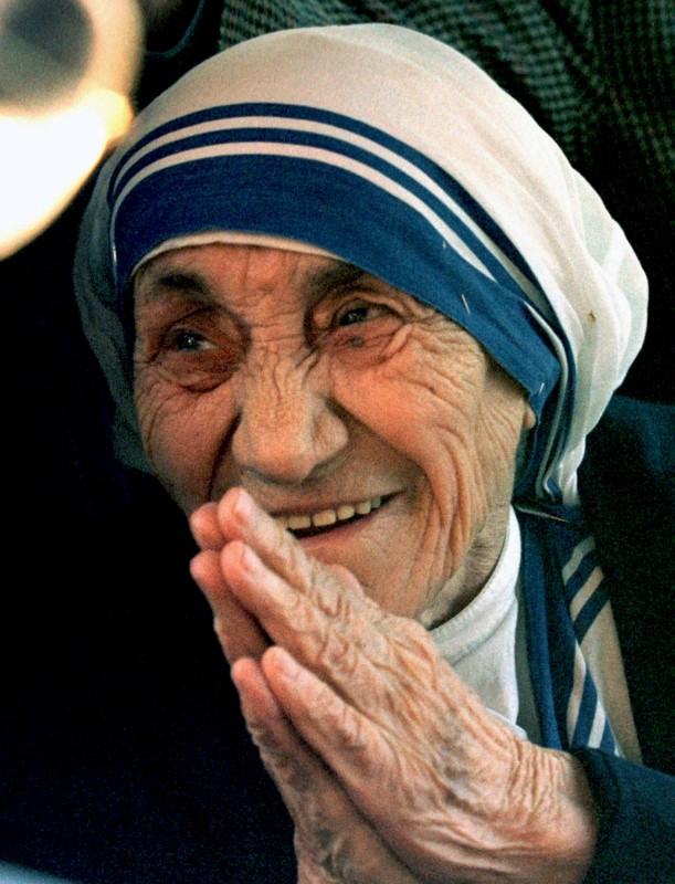 Mother Teresa of Calcutta greets journalists after arriving in Rome from New Delhi