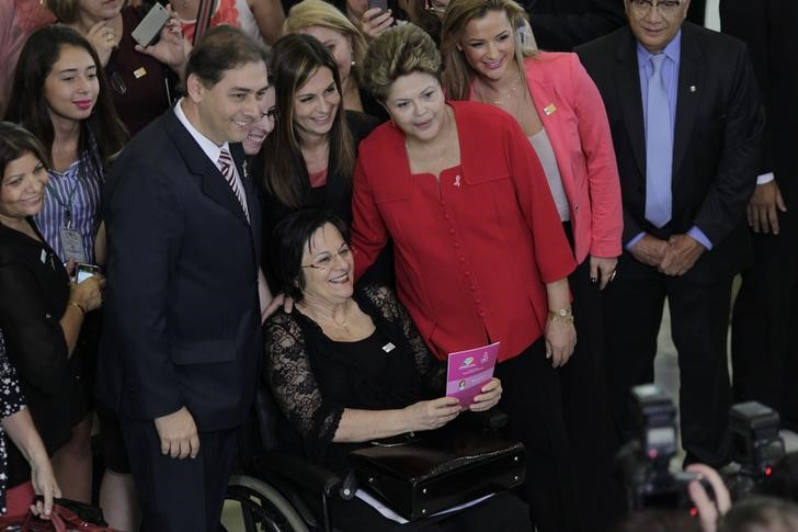 "Brazil's President Rousseff poses with women's rights activist Maria da Penha during the launch of the ""Woman: Living without Violence"" program in Brasilia"