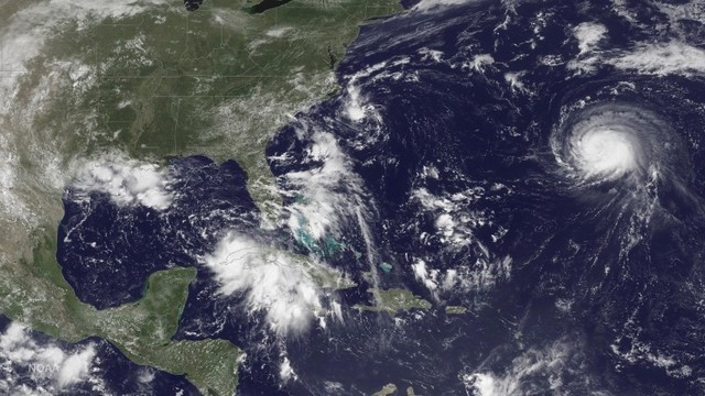 Three storm systems are shown (L TO R) Tropical Depression Nine to the southeast of Florida,