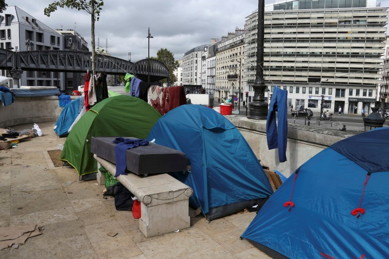 Migrants tents are seen at a makeshift camp on a street, northern Paris, France,
