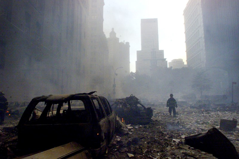 Firefighter walks amid the 9/11 rubble