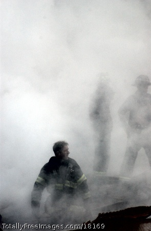 A firefighter emerges from the smoke and debris of the World Trade Center. The towers were destroyed in a Sept. 11 terrorist attack. U.S. Navy Photo by Photographer Mate 2nd class Jim Watson