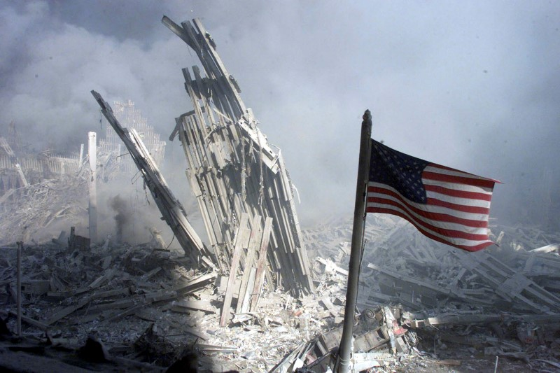 An American flag flies near the base of the destroyed World Trade Center in New York on September 11 2001