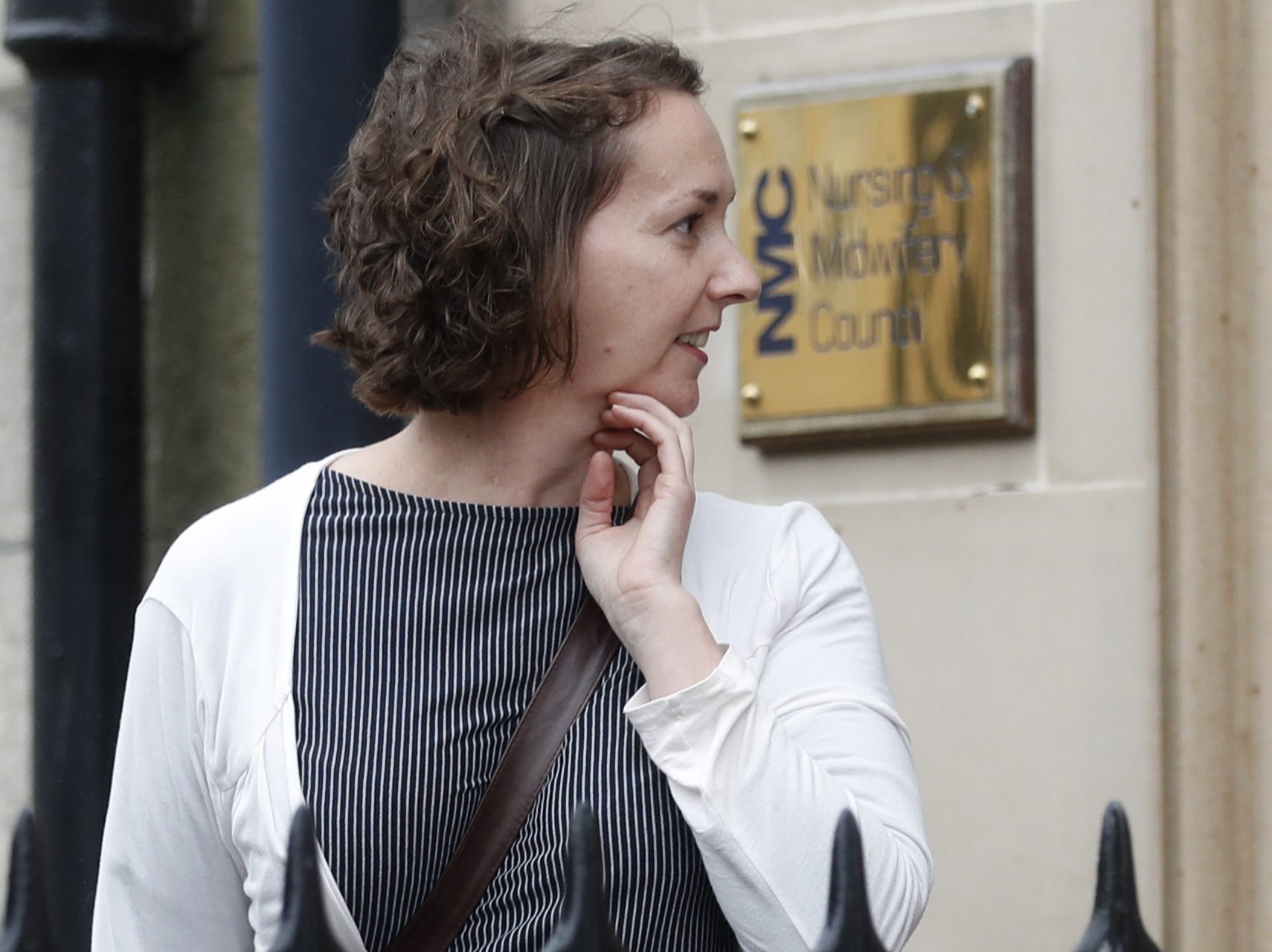 Pauline Cafferkey a nurse who volunteered volunteered to treat Ebola patients in West Africa, then survived the disease herself, leaves a hearing after being cleared of misconduct charges in Edinburgh, Scotland
