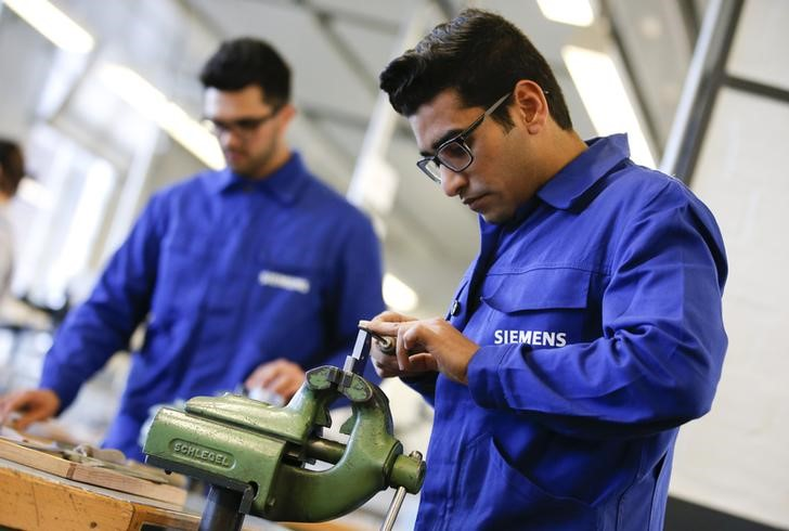 Refugees show their skills in metal processing works during a media tour at a workshop for refugees organized by German industrial group Siemens in Berlin, Germany,