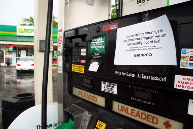 Out of fuel signs are pictured on gas pumps at a Mapco gas station at Spence Lane and Lebanon Pike in Nashville, Tennessee, U.S.