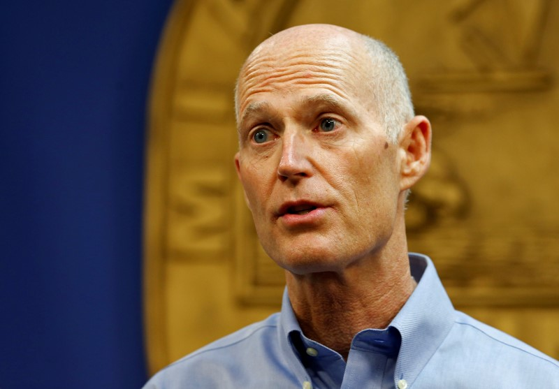 Florida Gov. Rick Scott speaks at a press conference about the Zika virus in Doral, Florida,